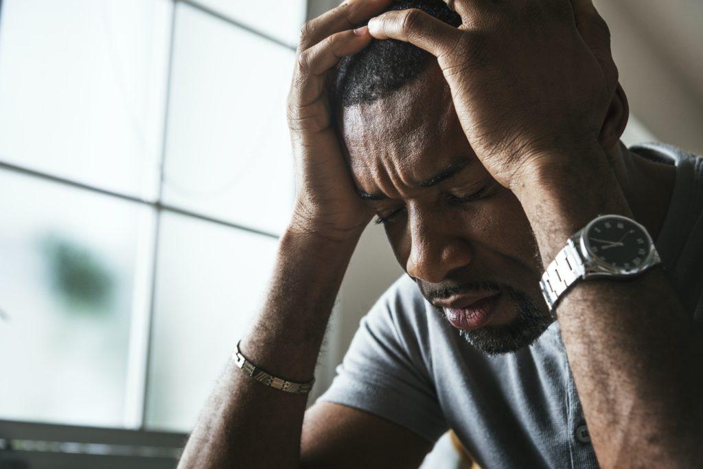 Black guy stressting and headache